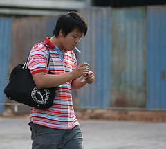 Young Chinese man smoking