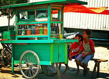 Two boys at a cafe, Makassar, Indonesia / photo: Mo Riza, flickr