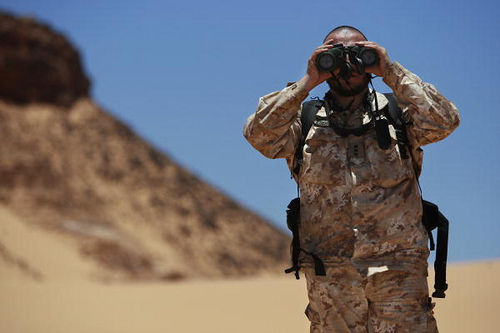 Antonio Achille, working with the Military Liaison Office of the UN Mission for the Referendum in Western Sahara (MINURSO), looks through binoculars during a ceasefire monitoring patrol in Oum Dreyg, Western Sahara.