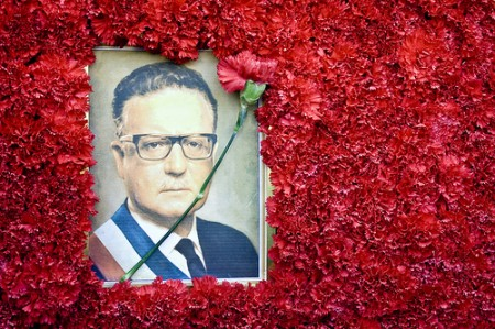 salvador allende with a background of flowers