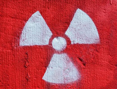 Graffiti displaying nuclear symbol.