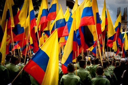 People march with Columbian flags