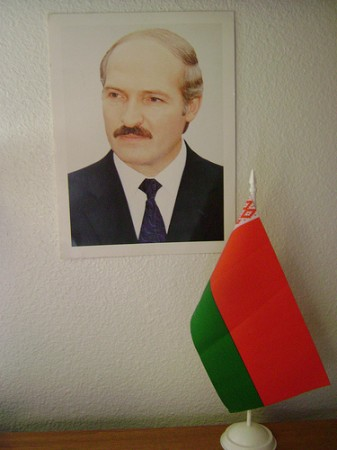 Photo of Belarus' President Lukashenko together with national flag